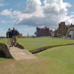 Me and my husband Wayne standing on the iconic bridge on the 18th hole at St. Andrews Golf Course in Scotland (A Bucket List Checked Off!)