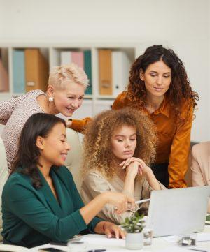 stylish-women-coworking-in-office-UTBPMGG.jpg